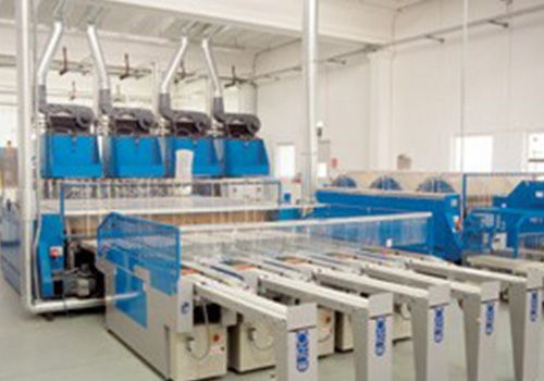 Automation and supervision of automatic machines for industrial laundry